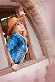 Beautiful woman in cowboy wild west style, cowboy hat and jeans jacket, fashion portrait photosession Royalty Free Stock Image