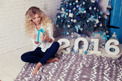 Beautiful woman  at cozy home, with presents and New Year decoration Royalty Free Stock Photos