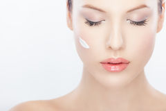 Beautiful woman with cream on her face Royalty Free Stock Photo