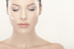 Beautiful woman with cream on her face Royalty Free Stock Photography