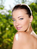 Beautiful woman with cream on shoulder Royalty Free Stock Photo
