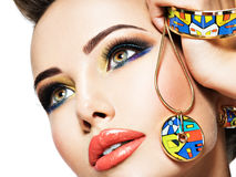 Beautiful woman with creative bright colored make-up. Royalty Free Stock Photos