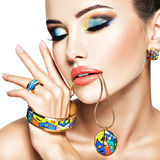 Beautiful woman with creative bright colored make-up. Stock Images