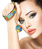 Beautiful woman with creative bright colored make-up. Stock Photo