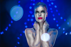 Beautiful woman with creative bright make-up Stock Photography