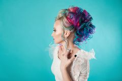 Beautiful woman with creative hair coloring. Stylish hairstyle, informal style. stock photo