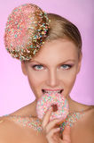 Beautiful woman, creative hairstyle bite of donut Royalty Free Stock Photography
