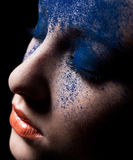 Beauty close-up portrait of beautiful woman model. Beautiful woman with creative make-up. On a black background Royalty Free Stock Photo
