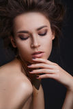 Beautiful woman with creative make-up and hairstyle Stock Images