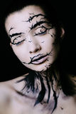 Beautiful woman with creative make-up halloween tree make-up stock image
