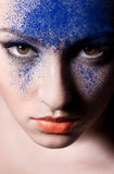 Beauty close-up portrait of beautiful woman model. Beautiful woman with creative make-up. A woman looks straight at the camera Royalty Free Stock Images
