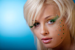Beautiful woman with creative makeup Stock Images