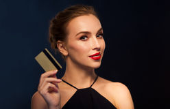 Beautiful woman with credit card over black Stock Photos