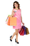 Beautiful woman with credit card and shopping bags isolated on w Royalty Free Stock Photo