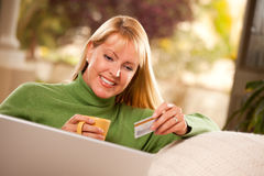 Beautiful Woman with Credit Card Using Laptop Stock Images