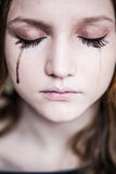 Beautiful woman cries. And sadness Stock Image