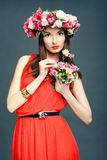Beautiful woman with a crown on head and bouquet Stock Images