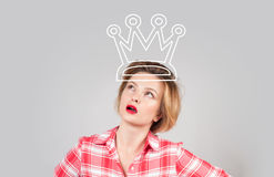 Beautiful woman with crown, looking up royalty free stock photography