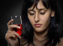 Beautiful woman crying with a glass of red wine Stock Photo