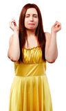 Beautiful woman crying in a yellow dress Stock Image