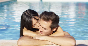 Beautiful woman cuddles with her boyfriend in pool Royalty Free Stock Photo