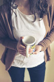 Beautiful woman with cup Stock Photography