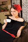Beautiful woman with cup in cafe Royalty Free Stock Images