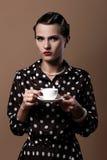 Beautiful woman with cup of coffee. Beautiful vintage woman with cup of coffee Stock Photo