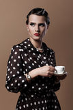 Beautiful woman with cup of coffee. Beautiful vintage woman with cup of coffee Royalty Free Stock Image