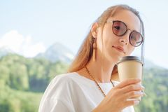 Beautiful woman with cup of coffee. royalty free stock images