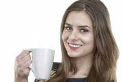 beautiful woman with a cup of coffee in hand Royalty Free Stock Photos