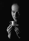 Beautiful woman, cup of coffee over black Royalty Free Stock Photos
