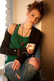 Beautiful woman with cup of coffee over window Royalty Free Stock Photo
