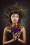 Beautiful woman with cup full of berries Stock Image