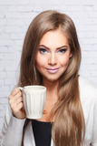 Beautiful woman with a cup of hot drink Stock Photo