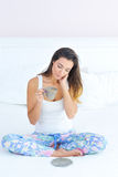 Beautiful woman with a cup of morning coffee in bed Stock Photos