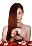 Beautiful woman and cup of rose petals. On white background royalty free stock photography