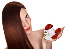 Beautiful woman and cup of rose petals Stock Images
