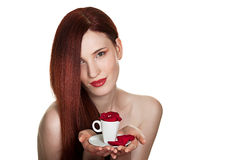 Beautiful woman and cup of rose petals Stock Photography