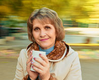 Beautiful woman with cup Royalty Free Stock Photography