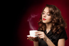 Beautiful woman with cup of tea Stock Photos
