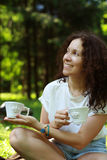 Beautiful woman and cups in the Park Royalty Free Stock Photo