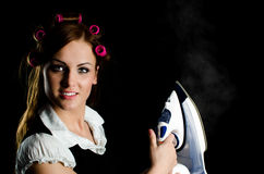 Beautiful woman with curlers Stock Photography