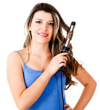 Beautiful woman curling her hair Royalty Free Stock Photo