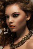 Beautiful woman with curls and makeup Royalty Free Stock Photography