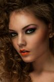 Beautiful woman with curls and makeup Royalty Free Stock Images