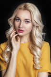 Beautiful woman with curly blond hair and evening make-up. Jewelry and Beauty. Fashion art photo Stock Image