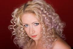 Beautiful woman with curly hair Stock Photos