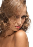 Beautiful woman with curly hair Stock Images