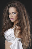 Beautiful Woman with Curly Hair. Beautiful Woman with Healthy Long Curly Hair stock photo